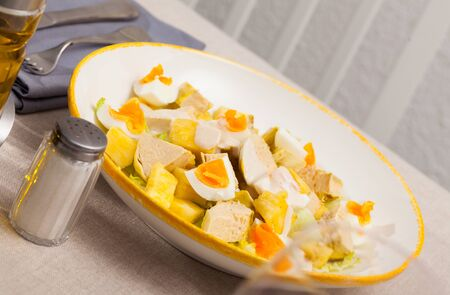 Image of tasty chicken salad with egg and pineapple at plate Stock Photo