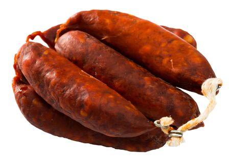 Popular Spanish smoked pork sausages chorizo. Isolated over white background