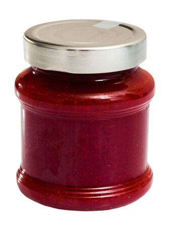 Glass jar of strawberry jam, closeup. Isolated over white background