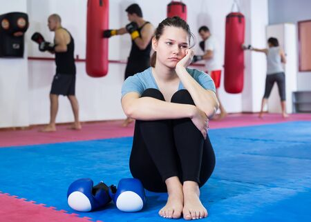 boxer girl is waiting for the start of training in the gym