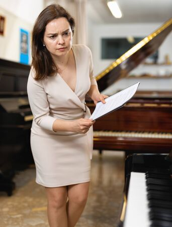 Saleswoman assistant in piano music store
