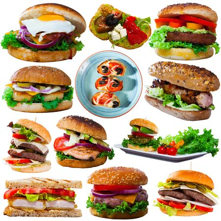 Set of various fast food dishes - burgers and sandwiches isolated on white background