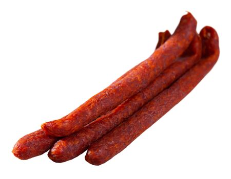 Appetizing Czech pork sausages traditionally smoked with cold smoke from aged beech. Isolated over white background Imagens