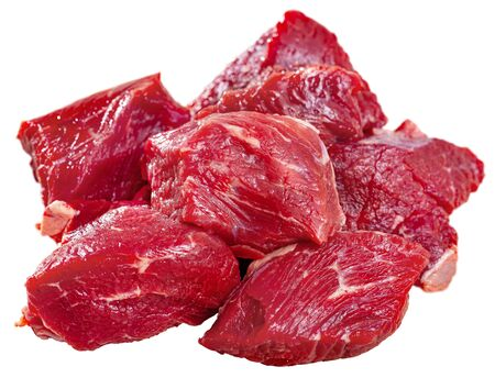 Diced of fresh raw veal fillet prepared for stew cooking. Isolated over white background