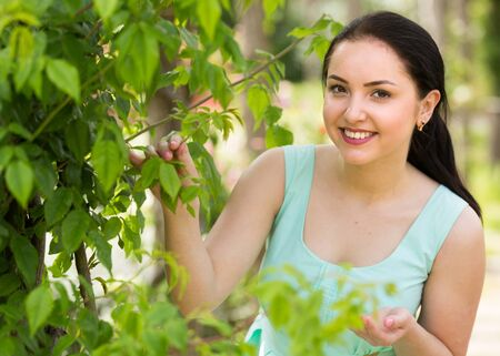 spring positive smiling young english female portrait in green garden