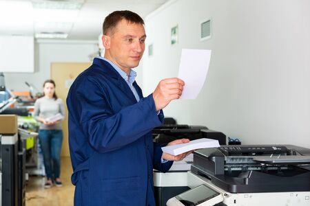 Service engineer of the printing house during work