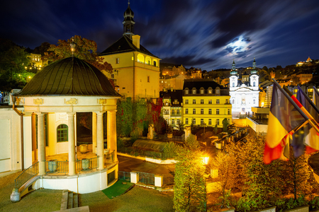 Night view of Karlovy Vary overlooking castle colonnade, castle tower and lighted church of St. Mary Magdalene, Czech Republic