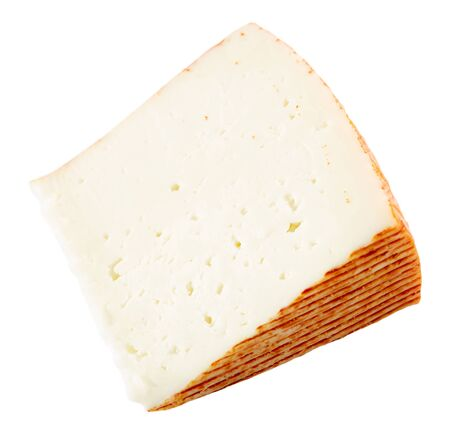 Sector of fresh semi-soft cheese. Isolated over white background