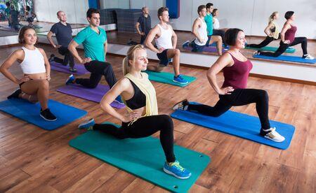 Happy active people relaxing and enjoying yoga elements