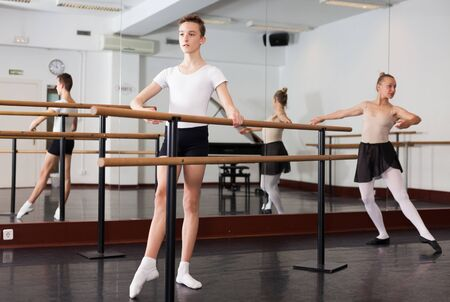 Young efficient dancer exercising in ballroom