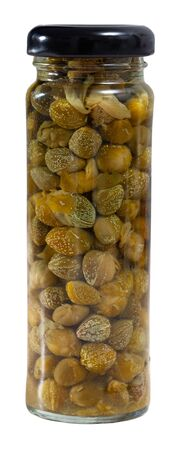 Vegetarian appetizer of canned capers in glass jar. Homemade pickles. Isolated over white background Foto de archivo