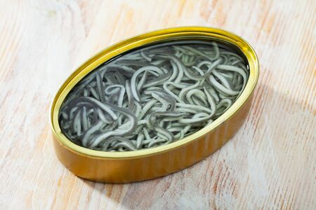 Picture of  tasty pickled  eels on wooden background, nobody Banco de Imagens