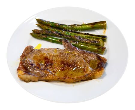 Beef entrecote with asparagus. Isolated over white background Stock Photo