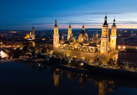 Night view of Cathedral Basilica in Saragossa with illumination, Aragon, Spain