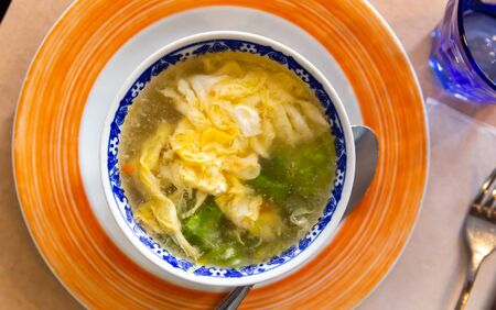 Bowl of tasty scrambled eggs bouillon with Chinese cabbage – Asian cuisine