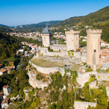Aerial view of mountainscape in commune of Foix with ancient fortified castle of Chateau de Foix, Ariege, France