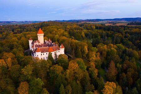 Picturesque autumn landscape with imposing historic �hateau Konopiste near small Czech town of Benesov at sunset