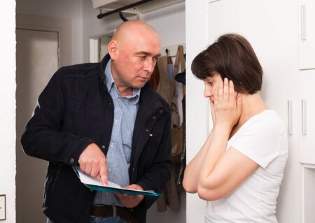 Businessman trying to collect arrearages from woman at home door
