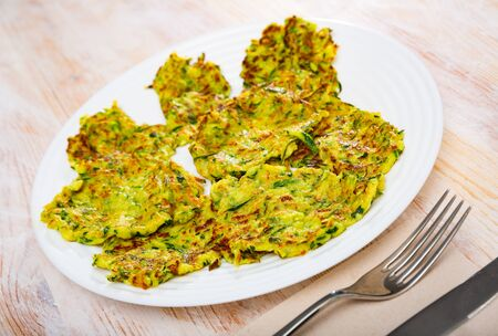 Vegetarian breakfast, fried zucchini patties with yogurt sauce Banco de Imagens