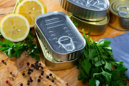 Close up of unlabeled yellow and silver tin cans Stock Photo