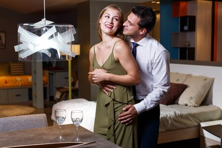 Romantic couple hugging and enjoying company of each other at home