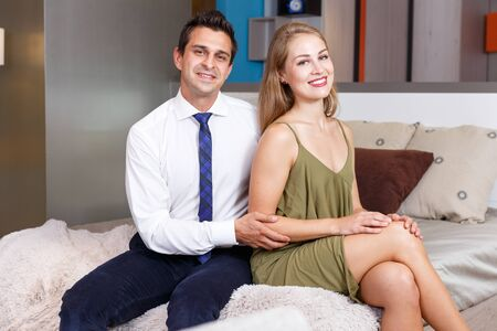 Attractive young woman and handsome elegant man having romantic time at home Stok Fotoğraf