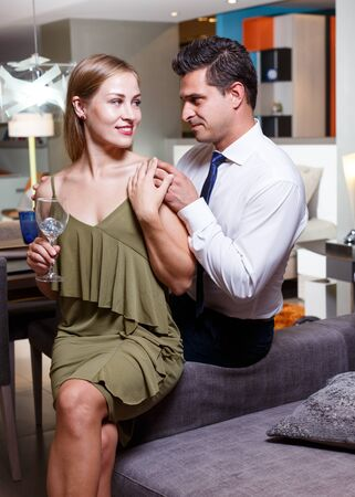 Portrait of beautiful loving couple spending time together in stylish apartment