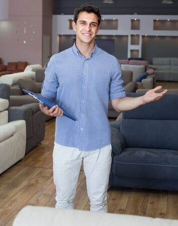 Salesman showing prices in home furnishings shop