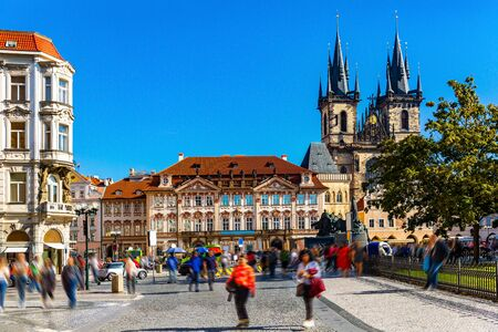 View of crowded Old Town Square (Staromestske namesti) in Prague overlooking impressive Gothic Church of Our Lady before Tyn on sunny autumn day, Czech Republic  Reklamní fotografie