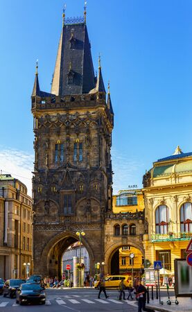 View of medieval Gothic Powder Tower (Powder Gate) connected by open arched bridge to impressive Municipal House on Republic Square in Prague, Czech Republic