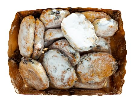 Traditional German sweet bread with nuts, spices and dried fruit, coated with powdered sugar (Mini stollens) in carton box. Isolated over white background