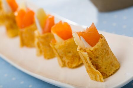 Pancakes rolls with salted salmon on a plate