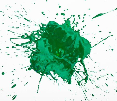 Artistic image of green paint spot spilled on background of white paper, nobody