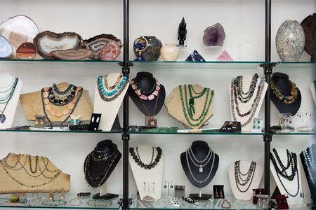 View of window of jewelry store offering various adornments from natural gemstones for sale Reklamní fotografie