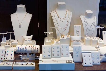 Gold jewelry at showcase of jewelry shop