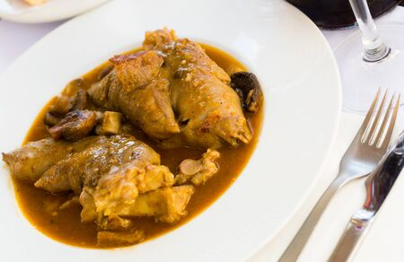 Delicious stewed pork knuckles and mushrooms – traditional Catalonian dish