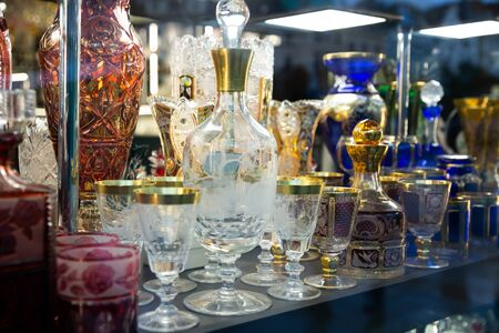Original Bohemian glass products on counter in czech souvenir shop Stok Fotoğraf - 137896340