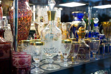Original Bohemian glass products on counter in czech souvenir shop