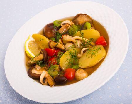 Mushroom soup prepared with boiled potatoes, shitake, tomatoes and greens  Stockfoto