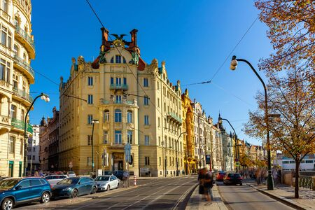 Picturesque view of Prague embankment on bank of Vltava river with peculiar architecture on autumn day, Czech Republic Stok Fotoğraf - 137895769