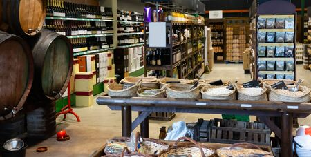Eco products store counter with large assortment of cereals, wine  and other goods for sale