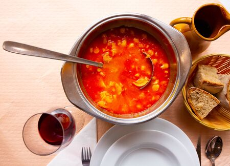 National Spanish dish Callos a la Gallega – thick broth with stewed tripe, vegetables and chilli pepper Фото со стока