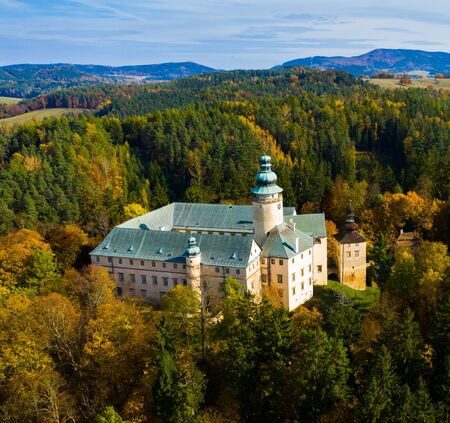 Aerial view of Lemberk Castle in autumn forest in Lusatian Mountains, near Czech village of Lvova