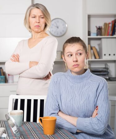 Mature woman and her adult daughter offended at each other after quarrel