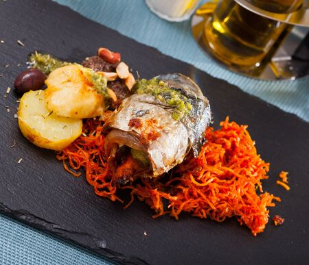 Appetizing mackerel roll with carrots and lard