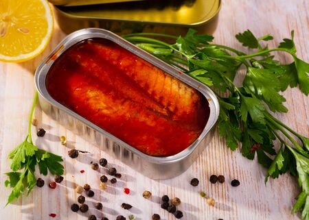 Open can of mackerel fillets in tomato sauce on wooden table Stok Fotoğraf