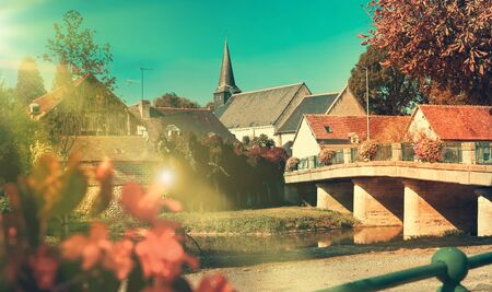 View of picturesque village in France under autumn blue sky