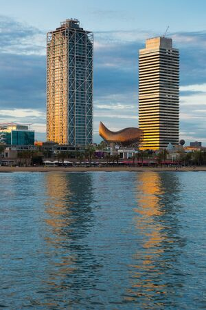 View from sea to two skyscrapers in modern area in coastal zone of Barcelona