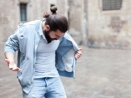 Upset man discovered loss of wallet from denim jacket