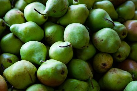 Fresh green pears as background. Closeup view of organic fruits Stock Photo